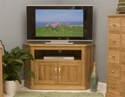 Mobel oak corner tv cabinet.